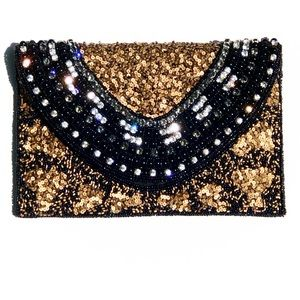 Black Clutch With 18KGP Base Metals
